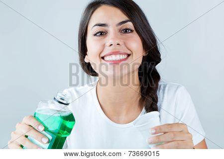 Beautiful Girl Using Mouthwash. Isolated On White.