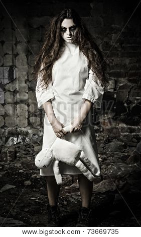 Horror Style Shot: Scary Monster Girl With Moppet Doll In Hands