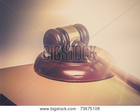 Rays of light shine on gavel and book...Judgement legal,religious concept image