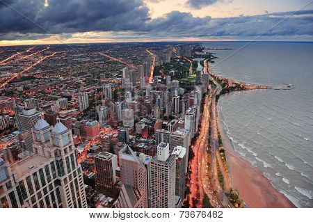 Chicago skyline panorama aerial view with skyscrapers over Lake Michigan with cloudy  sky at sunset.