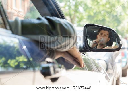 Smoking Young Man Reflection On Car Side Mirror