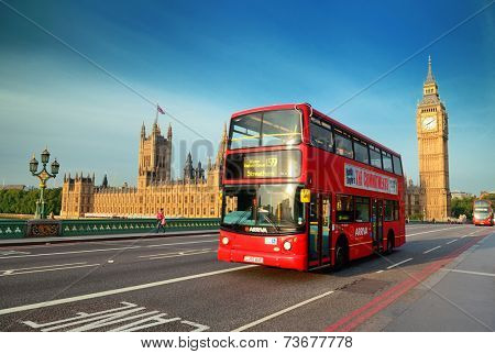 LONDON, UK - SEP 27: Street view with Big Ben and red bus on September 27, 2013 in London, UK. London is the world's most visited city and the capital of UK.