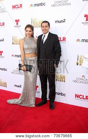 LOS ANGELES - OCT 10:  Josephine Ochoa, Rick Mancia at the ALMA Awards Arrivals 2014 at Civic Auditorium on October 10, 2014 in Pasadena, CA