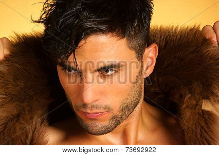 Portrait Of A Caucasian Young Man With Fur