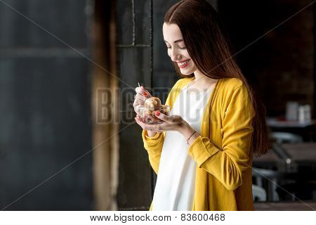 Woman eating ice cream in the cafe