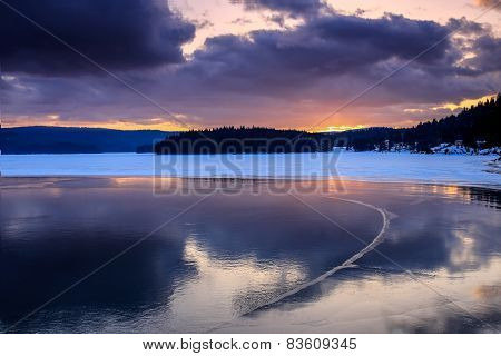Cold Lake In The Winter During Sunset