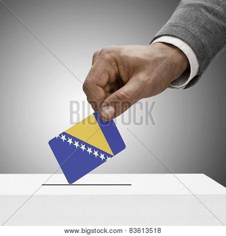 Black male holding flag. Voting concept - Bosnia and Herzegovina poster