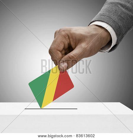 Black male holding flag. Voting concept - Congo-Brazzaville - Republic of the Congo poster