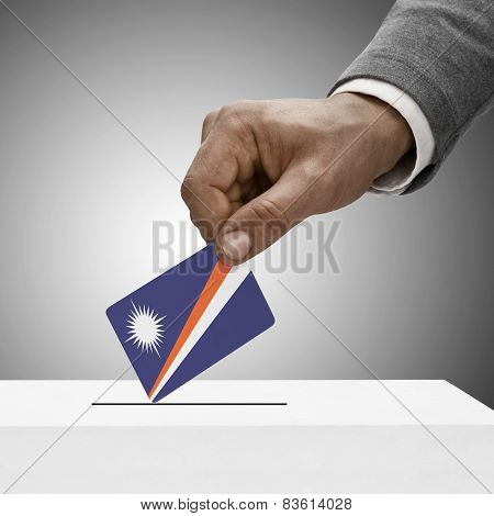 Black Male Holding Flag. Voting Concept - Marshall Islands
