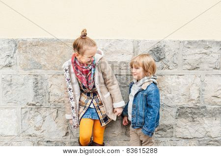 Fashion portrait of adorable kids outdoors