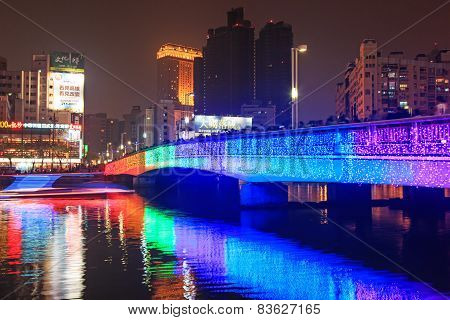 People walking on the bridge by the Love River of Kaohsiung during the celebrations for the Chinese
