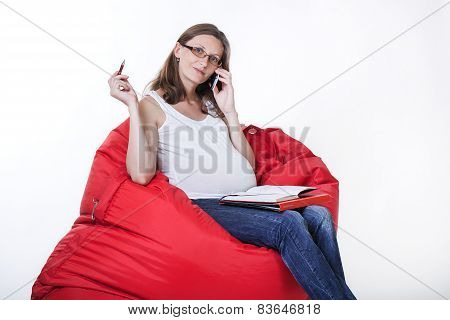 Pregnant woman in home office