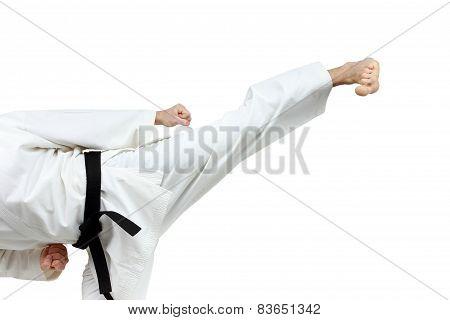 Man in karategi beats blow leg