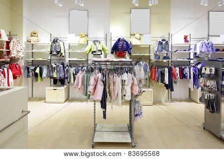 luxury and fashionable brand new interior of kids cloth store poster