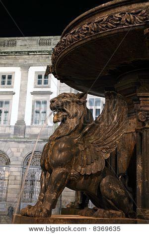 Lion fountain on Praca de Gomes at night Oporto Portugal poster