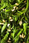 Homemade Sauteed Green Broccoli Rabe with Garlic and Nuts poster