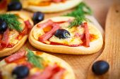 mini pizza with olives bacon and cheese poster