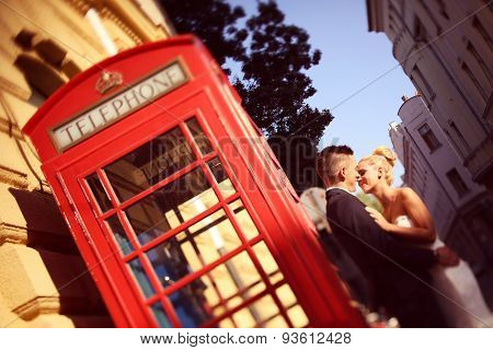 Bride And Groom Near Phonebooth