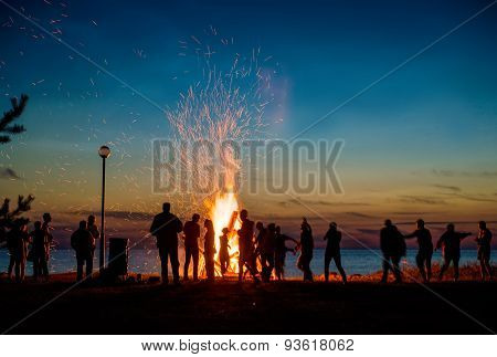 People Resting Near Big Bonfire Outdoor