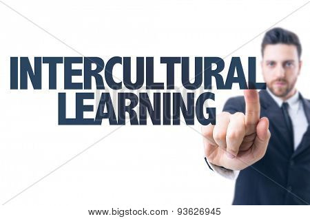 Business man pointing the text: Intercultural Learning