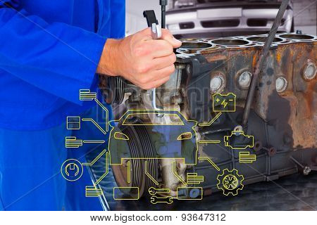 Male mechanic repairing car engine against auto repair shop