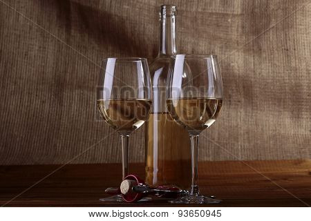 Two Glasses And Bottle Of White Wine