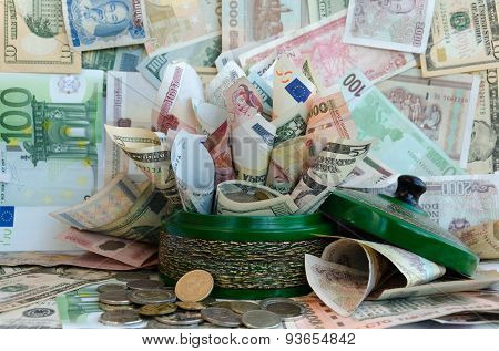 A lot of money in green moneybox