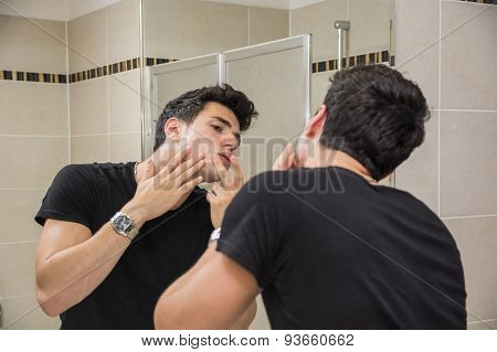 Young Man in Bathroom Squeezing a Spot