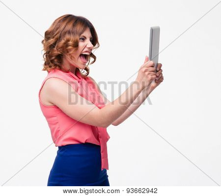 Angry woman shouting on tablet computer isolated on a white background