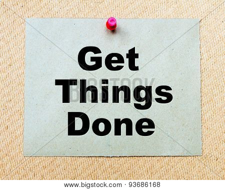 Get Things Done written on paper note pinned with red thumbtack on wooden board. Business conceptual Image poster