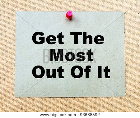 Get The Most Out Of It written on paper note pinned with red thumbtack on wooden board. Business conceptual Image poster