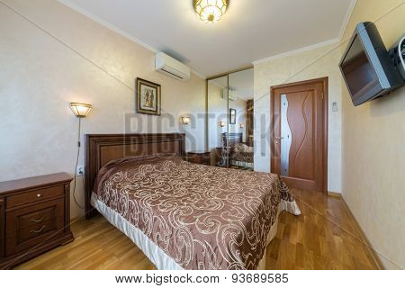 ADLER, RUSSIA - JULY 21, 2014: Interior of a hotel room with a double bed in El Paraiso hotel