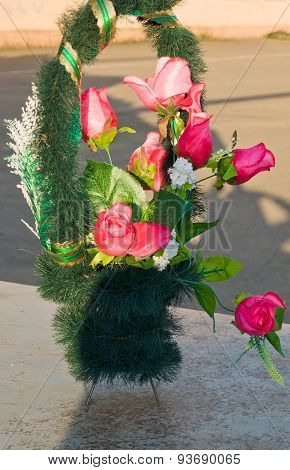 Wreath with roses on a granite slab