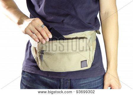 A man take smart phone from waist belt bag poster