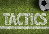 Soccer field with the text: Tactics poster