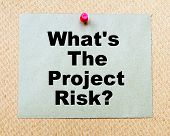 What's The Project Risk? written on paper note pinned with red thumbtack on wooden board. Business conceptual Image poster