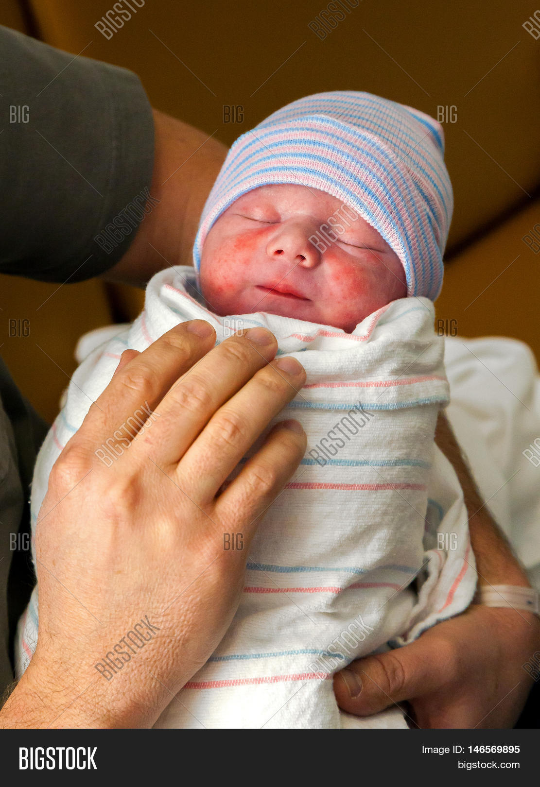 Brand New Baby Held Image & Photo (Free Trial)