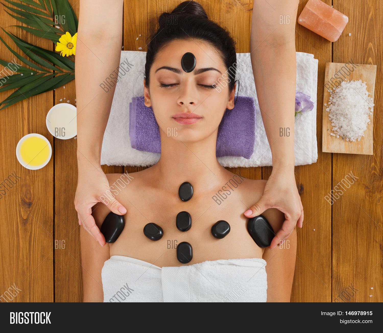 black marble stone massage spa. image & photo | bigstock