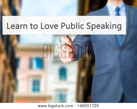 Learn To Love Public Speaking - Businessman Hand Holding Sign