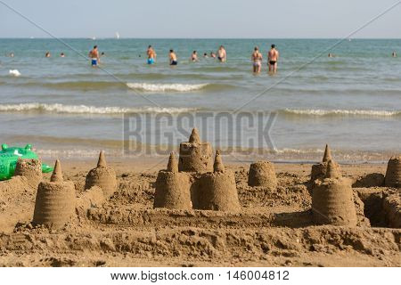several sand castles on the beach off the coast - Beach holiday