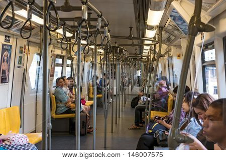 BANGKOK, THAILAND - 2 SEP - Crowded people on BTS sky train in the morning on September 2, 2016 in Bangkok, Thailand