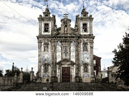 The Igreja de Santo Ildefonso is an eighteenth-century church and have approximately 11,000 blue tiles cover the facade.  The church is in Porto, Portugal, situated near Batalha Square.
