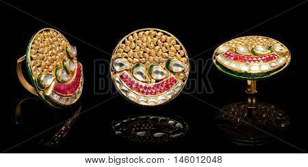Close up of a Gold and Diamond rings having many diamonds and gem. Isolated on black background. Multiple views.