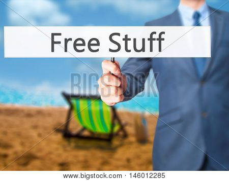 Free Stuff - Businessman Hand Holding Sign