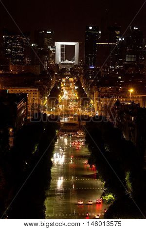 Paris France - September 08 2011 - La Defense by night shot from Arc de Triomphe - Avenue des Champs-Elysees is seen with a lot of cars