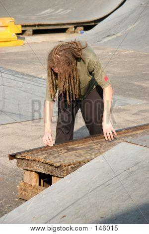 Boy Waxing Rail