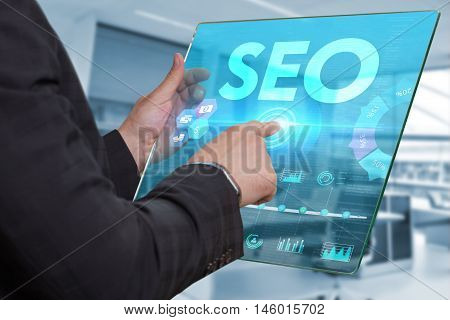 Internet. Business. Technology Concept. Businessman Presses A Button Seo On The Virtual Screen Table