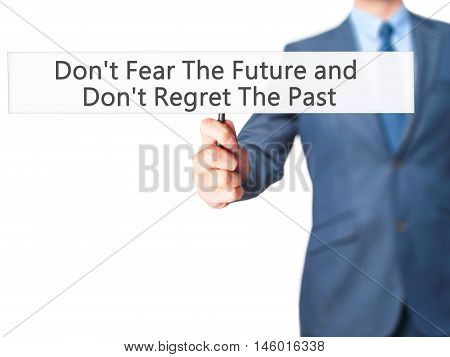 Don't Fear The Future And Don't Regret The Past - Businessman Hand Holding Sign