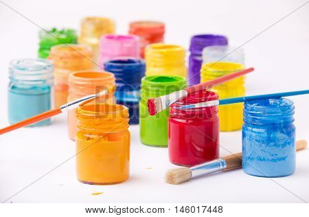 Paint In Glass Jars And Brush