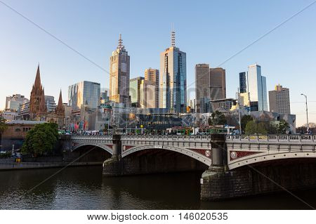Melbourne's skyline along the Yarra River at sunset towards Federation Square